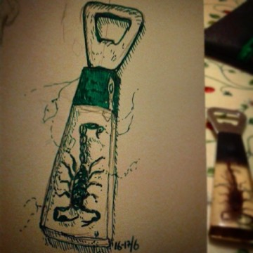 11/365. Bottle opener left to me by my dearly departed Nan. With actual scorpion. Probably as old as I am, if not older. A cautionary tale this. I began this drawing last night but soon became distracted by the beer I was opening with said bottle opener then was soon lost in revery of the evenings benison. Therefore the need to finish this now and slightly slide it over 2 days. I know far better and more talented people than me have tried this #365 thing and not made it, so I am cutting myself some slack on that one. I can promise you that the scorpion is real, I'd like to think it's encased in amber but it's much more likely to be come kind of mid to late 20th century plastic. I am not an expert on such dubious matters. Nor am I an expert in the moral jousting of owning arachnid based cutlery. A small part of me feels I ought to destroy it, but it is beautiful, and my Nan gave it to me, and besides I have become quite fond of the shrieking sound the children make when they unexpectedly discover it amongst the spoons. Ink and pencil. https://instagram.com/p/pZpaKjnyyW/